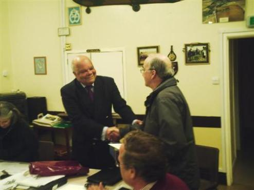 Parish Council Chairman Norman Bayne, presenting a gift to Colin Mills on his retirement as Salisbury District Councillor