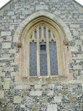 West window probably restored at the time of the not very sympathetic 1840s; church restoration by the architect T H Wyatt. Note the 19th century heads on the surrounding mullions