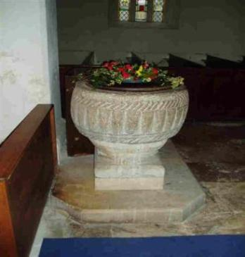 Font.  It is 12th century. For a time, during and after the 1840s restoration, this font was in the Vicar's garden as a birdbath, but was later restored to the church