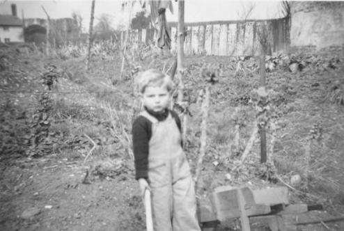 Gardening; 2 years old, 1949