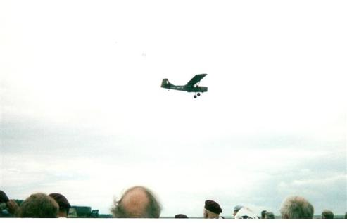 A Glider flies past during the ceremony at the Memorial to the Glider Pilot Regiment in Tilshead - Photograph - Anita Mundy