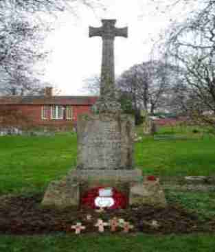 The War Memorial - St. Thomas à Becket Church Yard commemorating the men of Tilshead who did not return from the wars of 1914-1918 and 1939-1945. It is very remarkable to note the number of men from the Kyte family who died - Photograph: Michael Teale