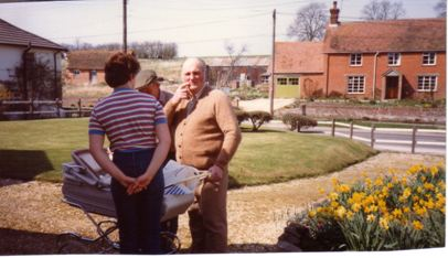 Looking across what is now Waylenfield Rachel Druce with Pete Waylen and David Kyte. With the end of Mill House on the left; Payne's Farm on the right. Background is Kyte's Farm before development. Who is in the Pram? 1985