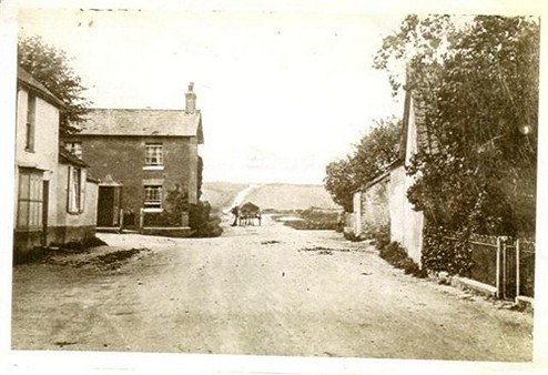 The High Street Circa 19th Century. Looking towards Lodge Hill with Corner House and Rose Cottage (still there today!) Before the trees on Lodge Hill were planted.