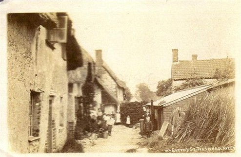 Black and white image of a row of cottages