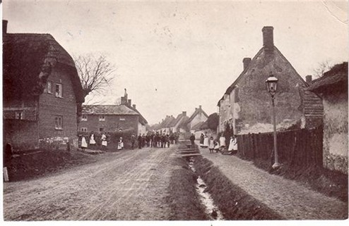 The High Street Circa 19th Century Elm Cottage, Mill Cottages (now Mill House) on the left; Rose Cottages on the right. All still standing. Note the open ditch with 'bridges' to the cottages.