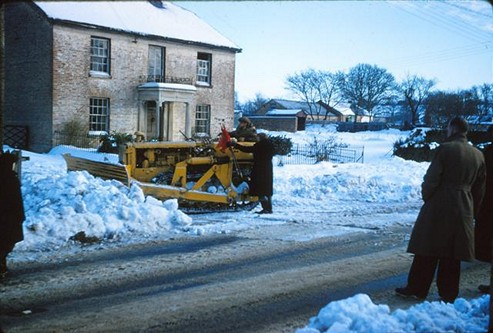 Clearing the snow. Georgie Kellow driving his bulldozer, 1963