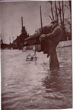 Man standing in flood water
